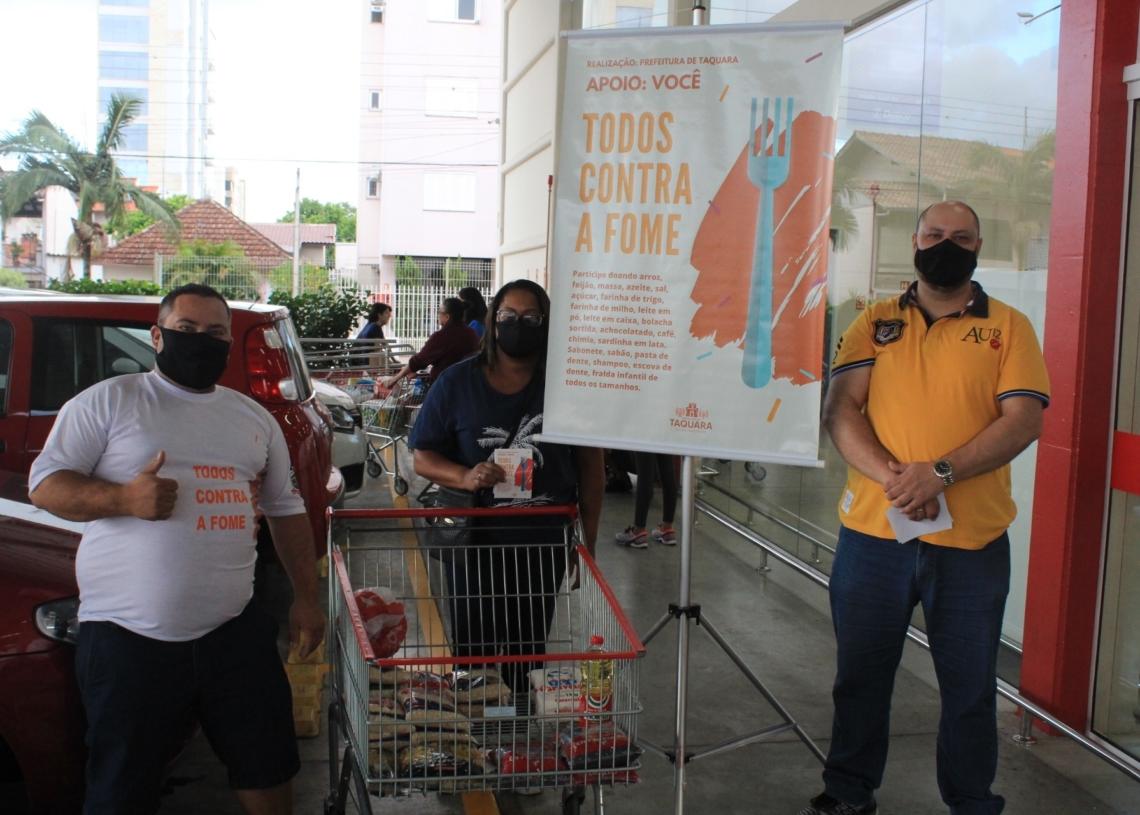 Voluntários em campanha na sexta-feira (5). Foto: Matheus de Oliveira