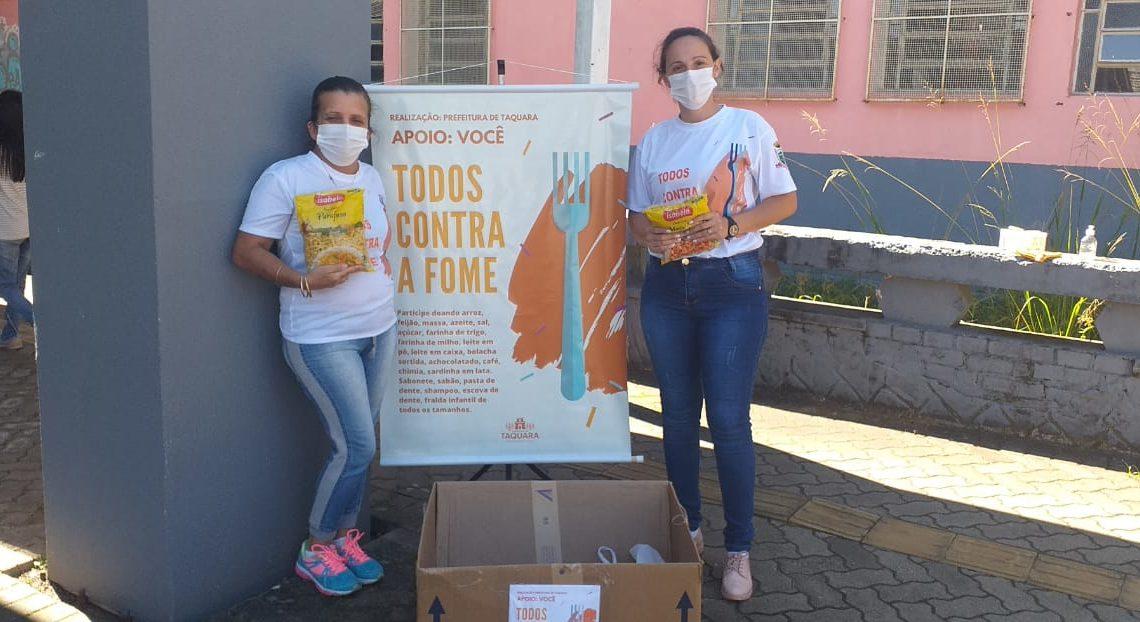 Funcionários do CRAS durante a arrecadação de alimentos. Créditos: Divulgação/CRAS
